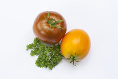 Tomato and parsley isolated on white Stock Image