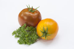 Tomato and parsley isolated on white Royalty Free Stock Photography
