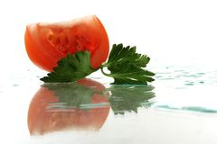 Tomato with parslwy Royalty Free Stock Photos