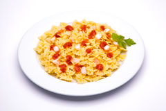 Tomato pasta dish. On white background royalty free stock images