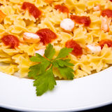 Tomato pasta dish. On dark background stock image