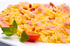 Tomato pasta dish. On white background stock photography
