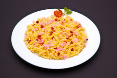Tomato pasta dish. On dark background stock photo