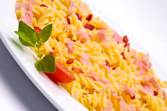 Tomato pasta dish. On white background royalty free stock photography