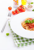Tomato pasta spaghetti with fresh tomatoes, basil, italian herbs and olive oil in a white bowl Stock Images