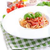 Tomato pasta spaghetti with fresh tomatoes, basil, italian herbs and olive oil in a white bowl Royalty Free Stock Photo