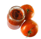 Tomato paste. Food ingredients - tomato paste jar royalty free stock image