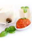 Tomato paste and basil Stock Photos