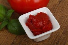 Tomato paste. With basil leaves Stock Photos