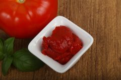 Tomato paste. With basil leaves Royalty Free Stock Photos