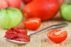 Tomato paste in spoon Royalty Free Stock Images
