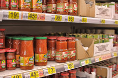 Tomato paste on supermarket shelves Stock Photography