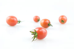 Tomato pearl. Joan of fruit, also known as the pearl of small tomatoes, a small cherry tomatoes, can vegetables can also fruit. Can also be made into preserves Stock Photos