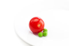 Tomato and peas Stock Images