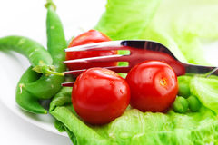 Tomato,peas and lettuce with a fork Royalty Free Stock Photos
