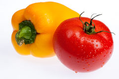 Tomato And Pepper. Isolated vegetable on white background royalty free stock photo