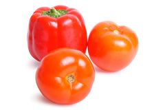 Tomato and pepper on white Stock Images