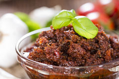 Tomato Pesto. (with Parmesan Cheese and Garlic) on wooden background Royalty Free Stock Photo