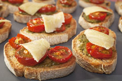 Tomato and Pesto Toasts Bruschetta Crostini Stock Photography