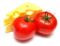 Tomato and a piece of cheese Royalty Free Stock Images