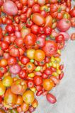 Village market colorful tomatoes. Group of mix tomatoes. Tomato pile for sale at farmers market. Fresh tasty tomatoes. Ripe tomatoes background. Tomatoes mix Stock Photography