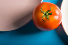 Tomato and pink plate stock photos