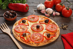 Tomato pizza. With some ingredients behind Royalty Free Stock Image