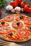 Tomato pizza. With some ingredients behind Stock Image