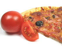 Tomato and pizza Royalty Free Stock Image