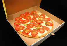 Tomato pizza in a box Royalty Free Stock Images