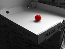 Tomato in a pizza box Royalty Free Stock Photo