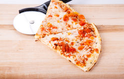 Tomato Pizza Slices with Cutter Stock Photo