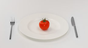 Tomato on plate Stock Photo