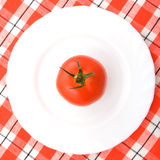 Tomato on the plate Stock Photos