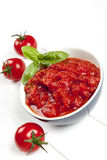 Tomato Puree with Basil. Tomato puree in bowl with cherry tomatoes and basil Royalty Free Stock Photography