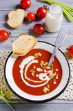 Tomato puree the soup. Tomato puree soup with cream in a metal bowl on a wooden background. Selective focus Royalty Free Stock Photo