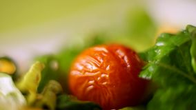 Tomato put hands in the salad. Macro. stock video footage