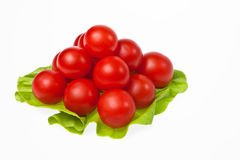 A tomato pyramid. A tomato pyramid on a lettuce leaf isolated on white background Stock Photo