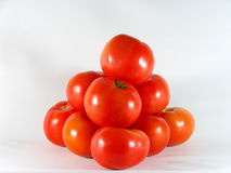 Tomato Pyramid. Fresh tomatoes piled like a pyramid Royalty Free Stock Image