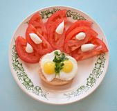 Tomato and quail eggs. On a plate Stock Images