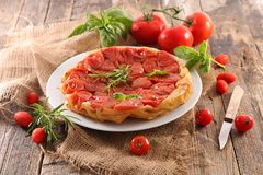 Tomato quiche tatin. On wood Royalty Free Stock Images