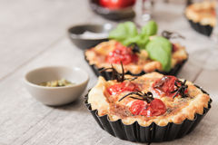 Tomato quiche with wine the national France. Tomato quiche with wine the national prescription France royalty free stock photo
