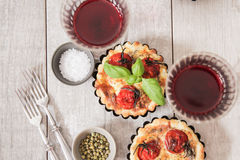 Tomato quiche with wine the national France. Tomato quiche with wine the national prescription France stock photos