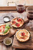 Tomato quiche with wine the national France. Tomato quiche with wine the national prescription France royalty free stock photos