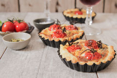 Tomato quiche with wine, the national prescription France.  royalty free stock images