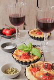 Tomato quiche with wine, the national prescription France.  stock image