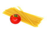 Tomato and raw pasta Royalty Free Stock Photography