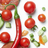 Tomato and red hot chili peppers royalty free stock photography