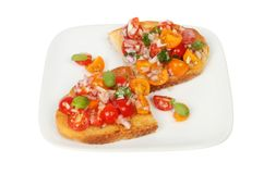 Tomato and red onion bruschetta. On a plate isolated against white Royalty Free Stock Image