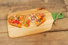 Bruschetta on rustic wood Stock Photography